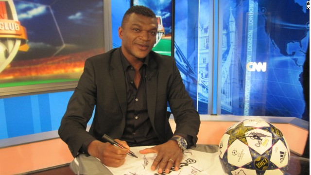 France World Cup star Marcel Desailly signs our special shirt and Champions League ball.