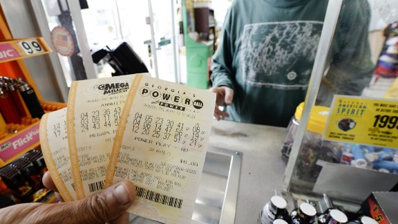 A customer purchases Powerball and Mega Millions lottery tickets in Decatur on May 17. The Powerball game is played in 43 states, the District of Columbia and the U.S. Virgin Islands.