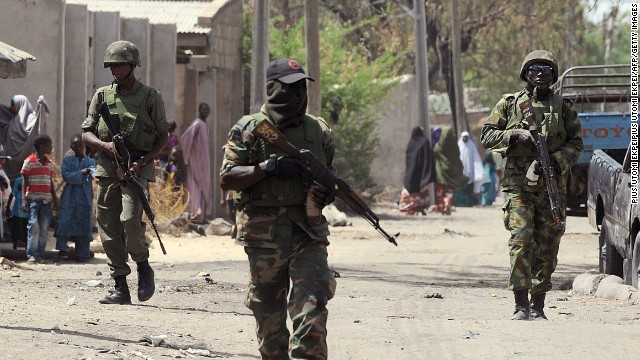 Nigerian troops patrol the streets of the remote northeast town of Baga, in Borno State, on April 30.