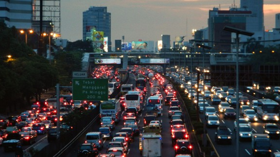 Unhappy time -- motorists are tied up commuting in Jakarta, Indonesia.