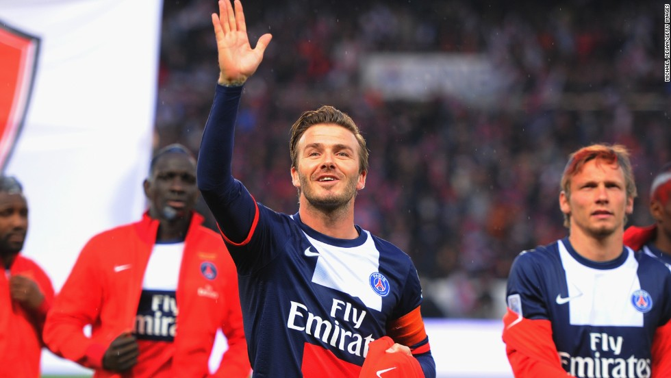 Beckham waves to his family and friends ahead of the match against Brest.