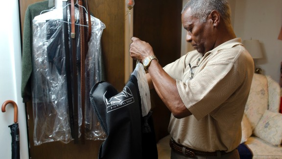Eugene Arms, another member of the Class of 1963, gets his suit ready for Friday night