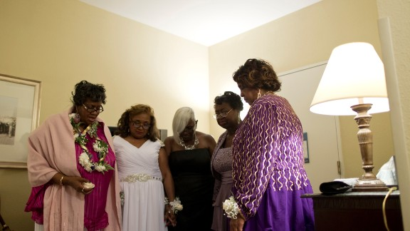 Classmates pause for a moment of prayer before the prom.