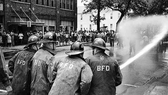 Images like this one on the streets of Birmingham, Alabama, in May 1963 triggered national outrage.