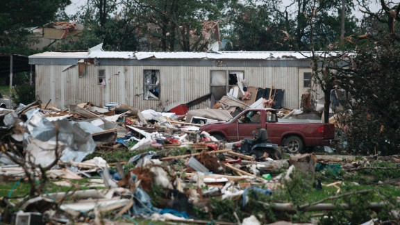 Debris from a mobile home park west of Shawnee litters the ground on May 19. An estimated 300 homes were damaged or destroyed across Oklahoma, Red Cross spokesman Ken Garcia said.