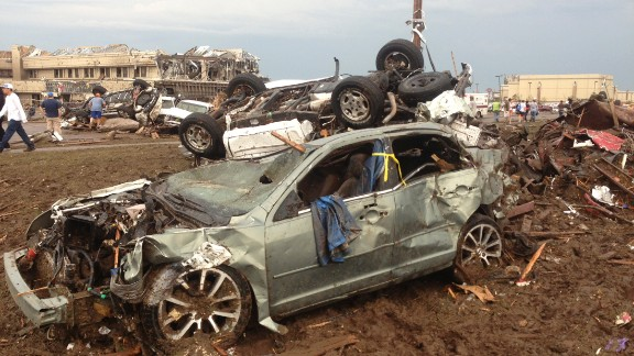 Overturned cars are among the rubble from the tornado that hit Moore on May 20.