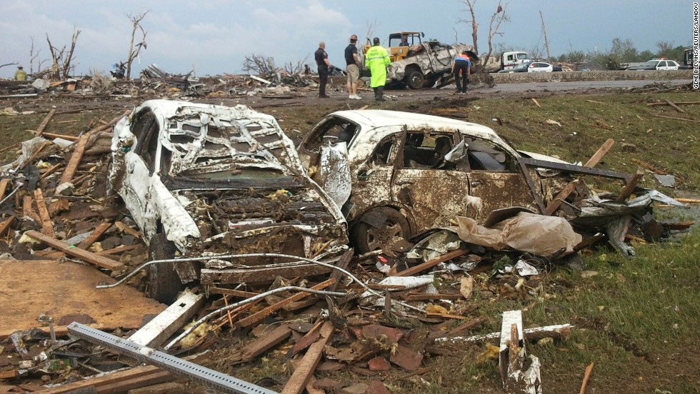 Destroyed cars scatter the landscape in Moore, Oklahoma, where hundreds of homes and buildings were put to ruin on May 20.