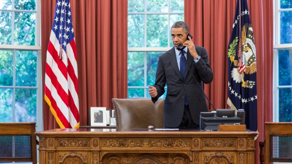 President Barack Obama talks on the phone with Oklahoma Gov. Mary Fallin from the Oval Office on May 20. The president expressed his concern for those who have been affected by the severe weather.