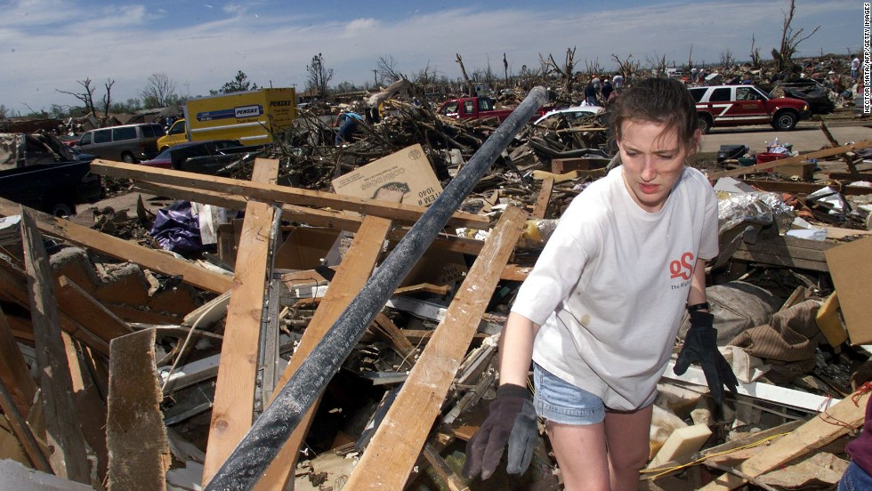 "Amber Landis walks among the remains of her home in Moore, Oklahoma, which was destroyed by an EF5 tornado on May 3, 1999. Forty-six people were killed in a <a href=""http://www.cnn.com/2013/05/20/us/oklahoma-1999-tornado/index.html"">string of tornadoes</a> that tore through Oklahoma on May 3, 1999, the strongest of which was an EF5 that hit the towns of Moore, Bridge Creek, Newcastle, Midwest City and Del City. Now this section of the country is dealing with <a href=""http://www.cnn.com/2013/05/20/us/severe-weather/index.html?hpt=hp_t1"">a fresh disaster that has eclipsed the 1999 outbreak</a>. Click through the gallery to see more pictures from 1999:"