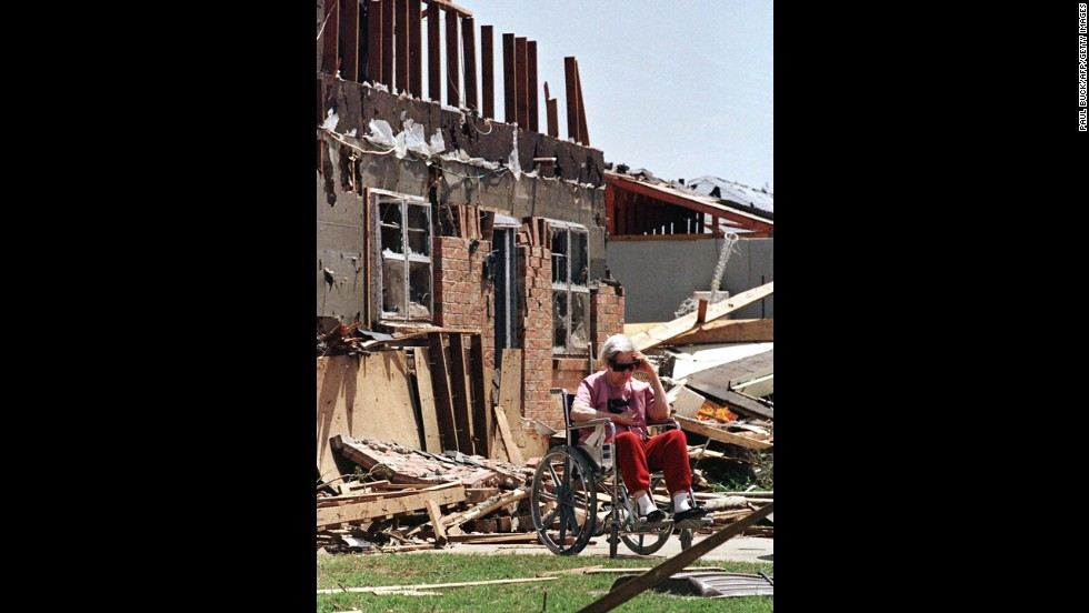 Velma Briscoe of Moore sits in front of what was her home on May 4, 1999.