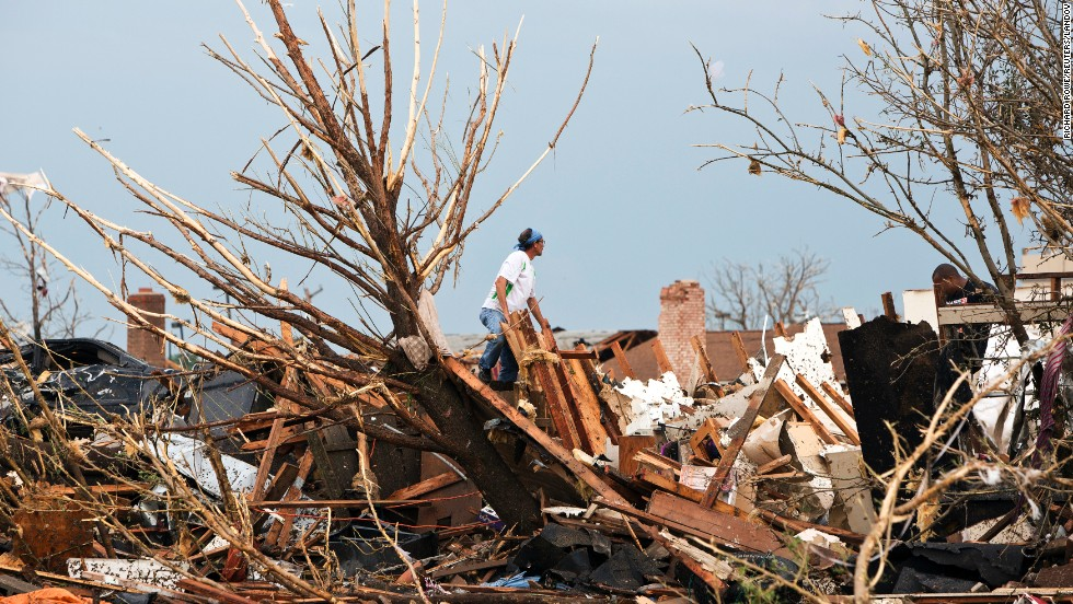 A man looks through the remains of a home after the massive tornado struck Moore on May 20.
