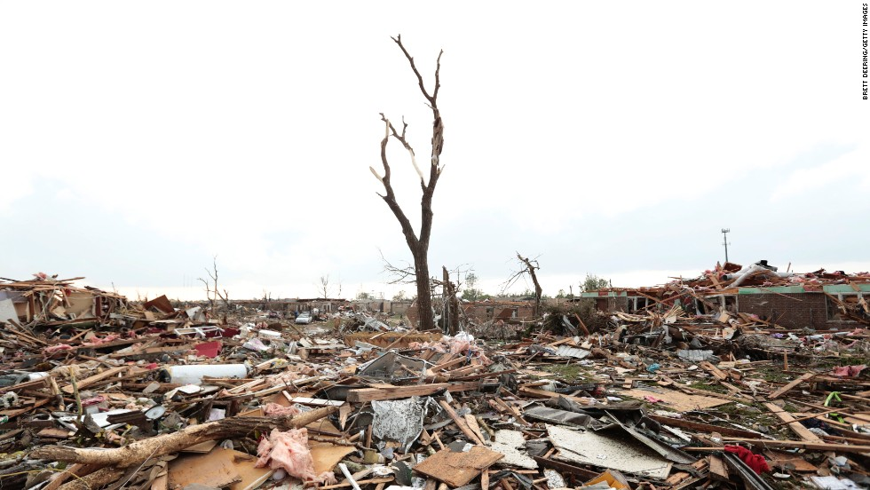 "Massive piles of debris cover the ground after a powerful tornado ripped through Moore, Oklahoma, on May 20. <a href=""http://www.cnn.com/2013/05/20/us/gallery/moore-oklahoma-tornado/index.html"">View photos related to the Moore tornado.</a>"