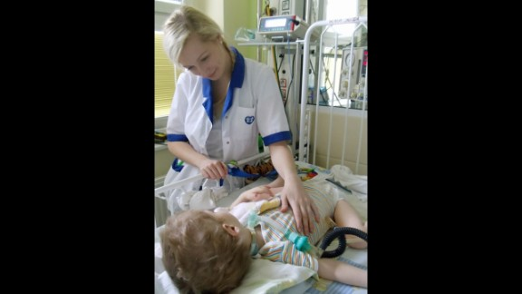 Nurse Katarzyna Kaseja, 25, comforts a patient at a Poznan, Poland, hospital.