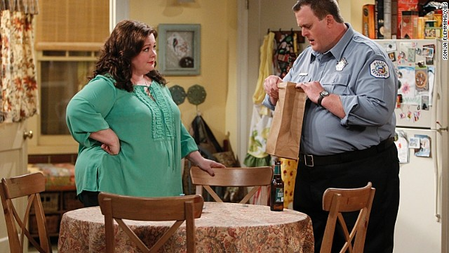 "Molly (Melissa McCarthy, left) gives Mike (Billy Gardell, right) his boss' personal belongings on the pulled episode of ' ""Mike &Molly."""