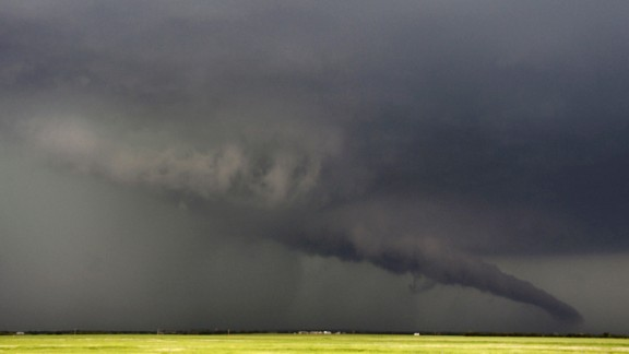 A funnel cloud stretches toward the ground near South Haven, Kansas, on May 19. As many as 28 tornadoes were reported in Oklahoma, Kansas, Illinois and Iowa on Sunday and Monday, according to the National Weather Service, with Oklahoma and Kansas the hardest-hit, including a EF4 storm that devastated Moore, Oklahoma.