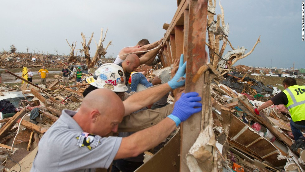 Two-mile-wide tornado slams Oklahoma City area, killing at