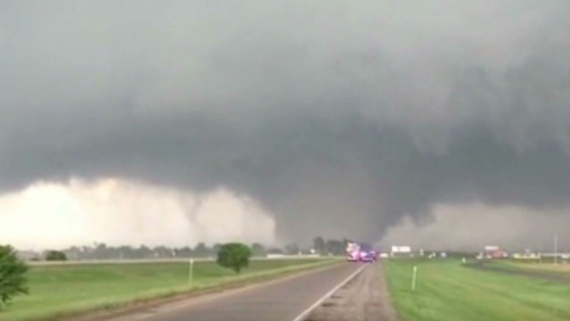 See tornado devour roof in Oklahoma