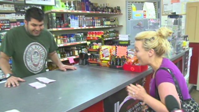 See stunned woman claim $1M lottery loot