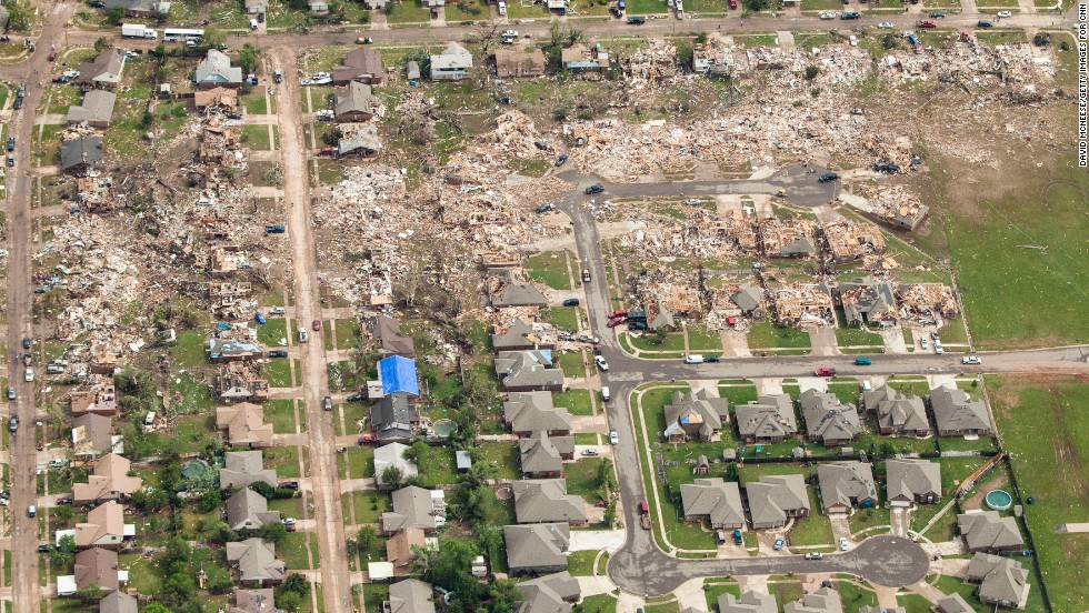 "An aerial view of the destruction caused by the massive tornado that struck areas south of Oklahoma City on Monday, May 20, shows the magnitude of damage left in its path. The storm's winds topped 200 mph as it <a href=""http://www.cnn.com/2013/05/21/us/severe-weather/index.html?hpt=hp_t2"">carved a 17-mile path of destruction</a> through Oklahoma City suburbs. On Tuesday, May 21, CNN sent photographer David McNeese to capture the story from above:"