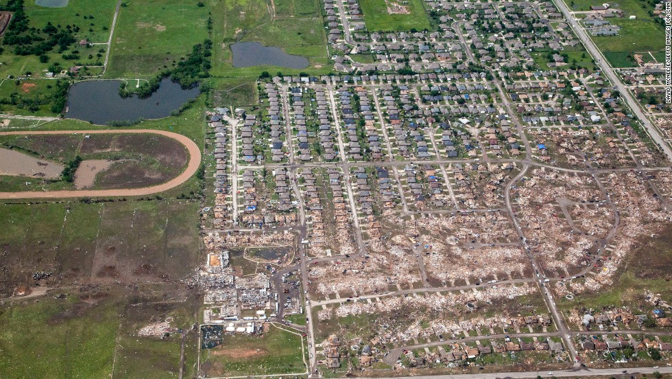 The path of the tornado is clearly visible with dirt and debris painting a wide path across the Oklahoma landscape.