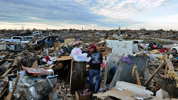 Residents salvage belongings from their demolished homes in Moore on May 21.