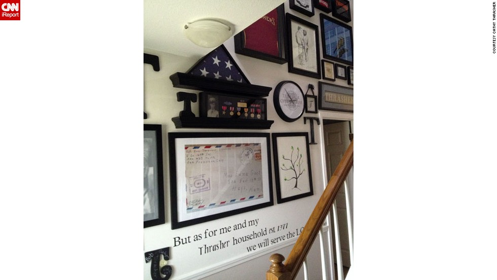 "<a href=""http://ireport.cnn.com/people/Thrasher4031"">Cathy Thrasher</a>'s entryway is a gallery dedicated to the legacy of her family name. It includes a framed blowup of the envelope that delivered a love letter from her father-in-law to his future bride during WWII, personalized scripture and lots of military memorabilia. ""Thrasher is a word of strength and as our last name we cover every aspect of our personalities,"" Cathy writes."