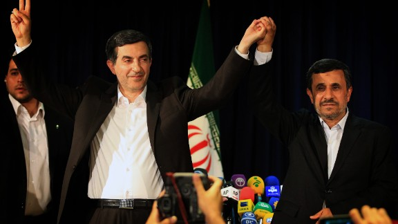 President Mahmoud Ahmadinejad, right, and Esfandiar Rahim Mashaei wave during a conference in Tehran on May 11.