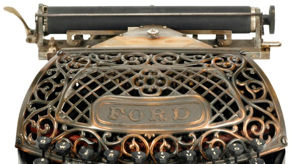 An 1895 Ford typewriter with filigree copper grille. The invention of typewriters in the mid 19th century changed the face of professional writing. The QWERTY keyboard is still the most common modern-day keyboard layout.