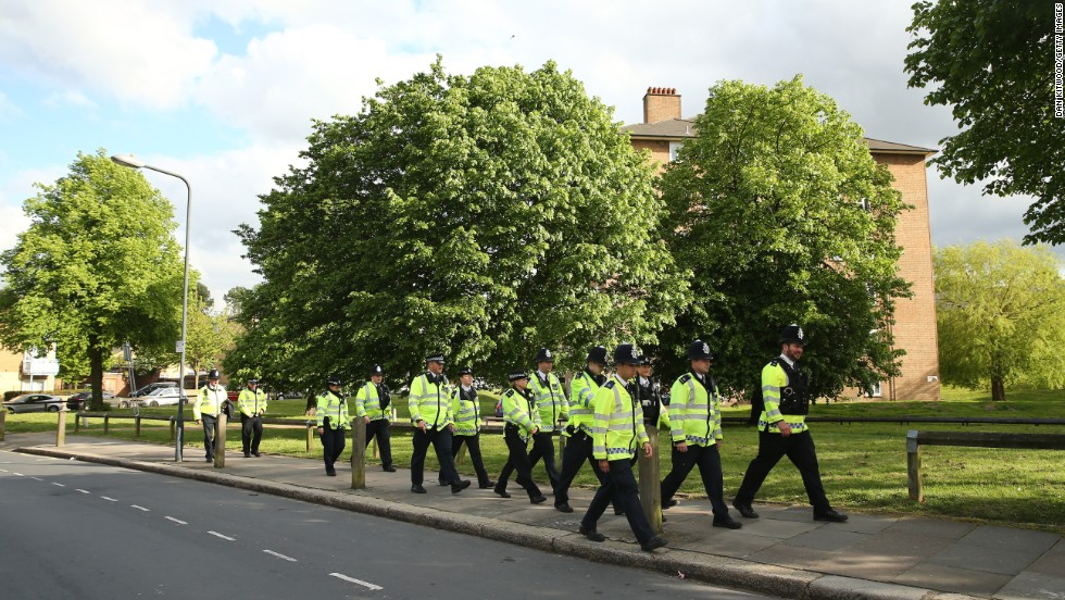 Police walk to the scene in Woolwich on May 22.