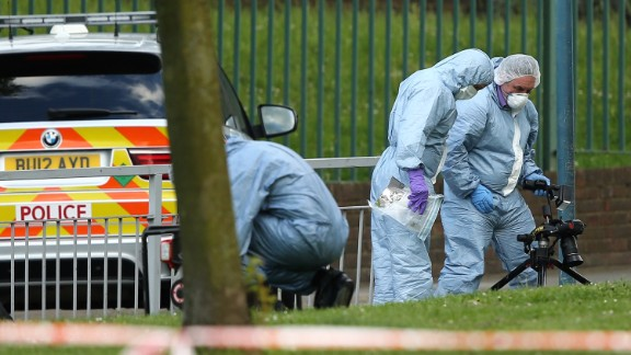 Forensic officers investigate the crime scene on May 22.