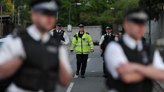 Police officers block off a road in Woolwich.