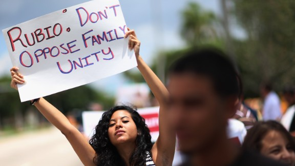 Mariana Rivas urges changes in the immigration bill, protesting in front of Sen. Marco Rubio's (R-FL) office in Doral, Florida.
