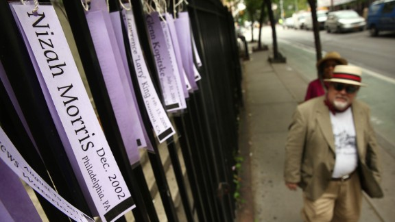 The names of victims of bias crimes are displayed on ribbons at a church on Christopher Street in New York City on May 22, 2013.
