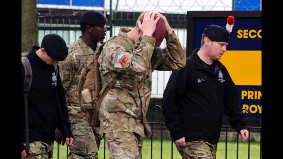 Soldiers walk outside Woolwich Barracks on Thursday, May 23, near where the soldier was killed.