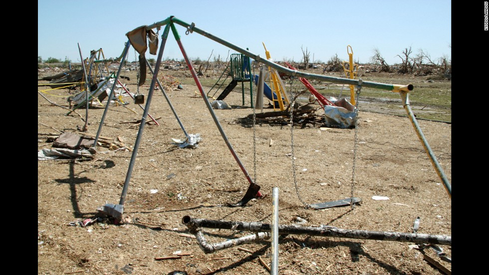 A  swing set sits warped at Plaza Towers Elementary School on May 22.