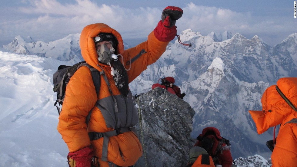 Fellow climber Sandra LeDuc captured this photo of a triumphant and relieved Kedrowski reaching the summit of Mount Everest on May 26, 2012.
