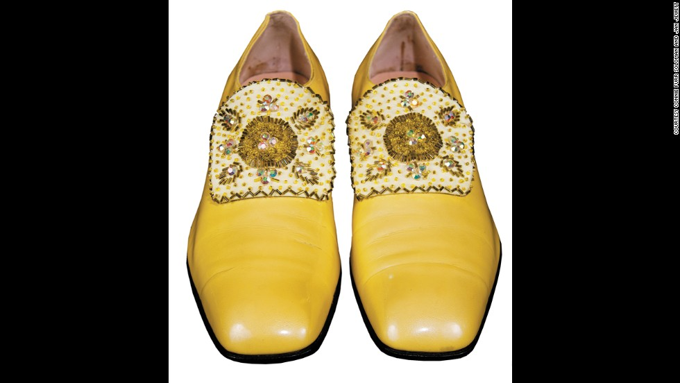 Liberace focused on the details from head to toe, such as with these yellow shoes.
