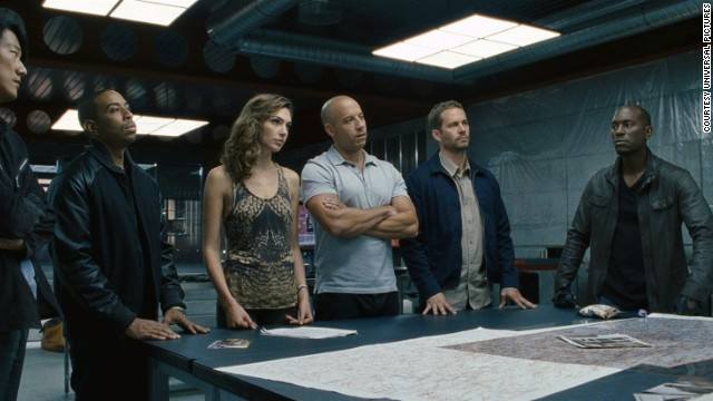 "Sung Kang (from left), Ludacris, Gal Gadot, Vin Diesel, Paul Walker and Tyrese Gibson in ""Fast and Furious 6."""