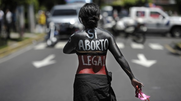 A woman participates in a march on the International Day of Action for the Decriminalization of Abortion, on September 28, 2012 in San Salvador