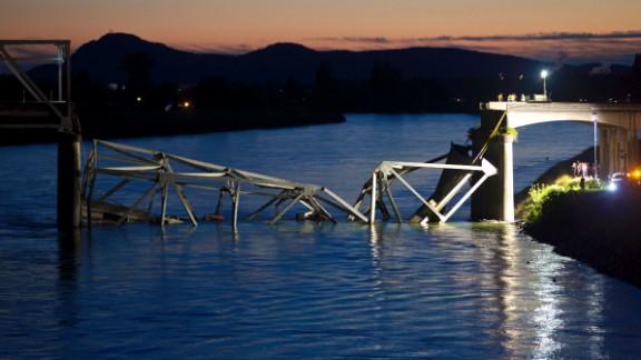 Crews survey the scene of a Skagit River bridge collapse on Interstate 5 near Mt. Vernon, Washington, on Thursday, May 23.