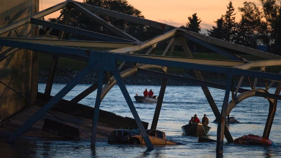 Search and rescue boats comb the water for victims after the collapse on May 23.