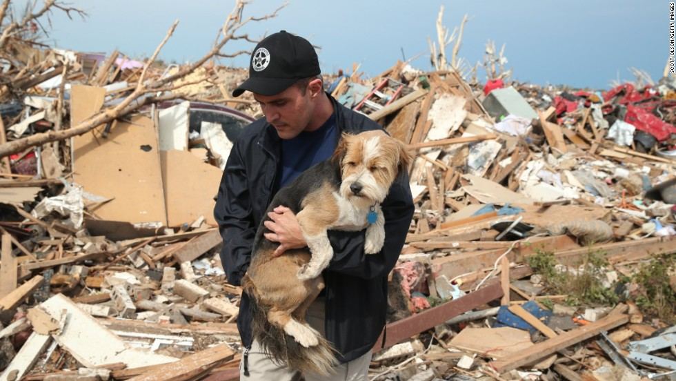 "Sean Xuereb recovers a dog from the rubble of a home that was destroyed by the massive tornado that hit Moore, Oklahoma, on Monday, May 20.   A website has been set up to help <a href=""http://www.okclostpets.com"" target=""_blank"">lost and found pets</a>, and shelters have been set up to help displaced and injured animals. For ways to help, visit <a href=""http://www.cnn.com/SPECIALS/impact.your.world/"">CNN.com/impact.</a>"