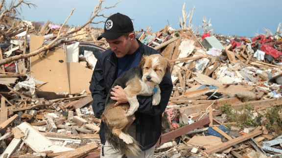 Sean Xuereb recovers a dog from the rubble of a home that was destroyed by the massive tornado that hit Moore, Oklahoma, on Monday, May 20.   A website has been set up to help lost and found pets, and shelters have been set up to help displaced and injured animals. For ways to help, visit CNN.com/impact.