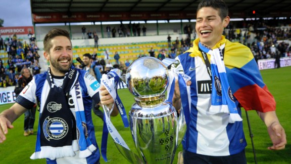"""Monaco's spending spree began with the recent signing of Joao Moutinho (left) and James Rodriguez from Porto for $90 million. Pictured holding the Portuguese league title after Porto's 2013 triumph, former Monaco chief executive Tor-Kristian Karlsen describes the duo as """"two of the best midfielders in European football."""""""