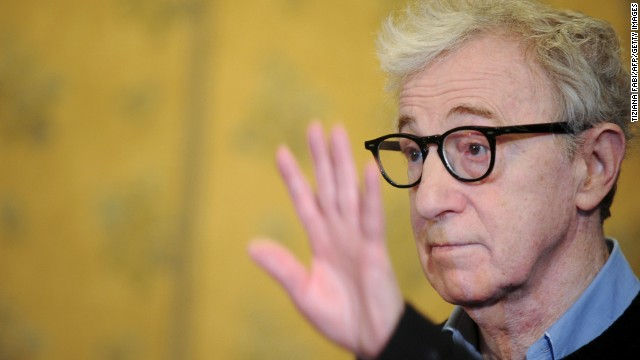 "US film director Woody Allen waves during the photocall of ""To Rome With Love"" on April 13, 2012 at a hotel in Rome.  ""To Rome With Love"" is directed by US Woody Allen.    AFP PHOTO / TIZIANA FABI (Photo credit should read TIZIANA FABI/AFP/Getty Images)"