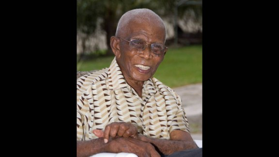 """James Sisnett was born February 22, 1900, in Barbados. He made it to 113 and believed he lived that long by eating good food; having a daily """"little one,"""" his name for an alcoholic drink; and """"God"""
