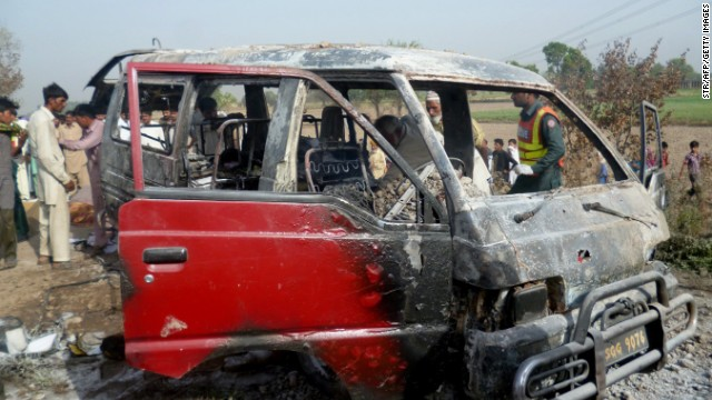 The charred wreckage of the school van.