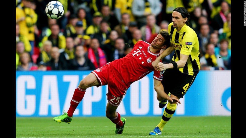 Thomas Mueller, left, of Bayern Munich goes after the ball against Neven Subotic of Borussia Dortmund during the UEFA Champions League final match at Wembley Stadium in London on May 25.