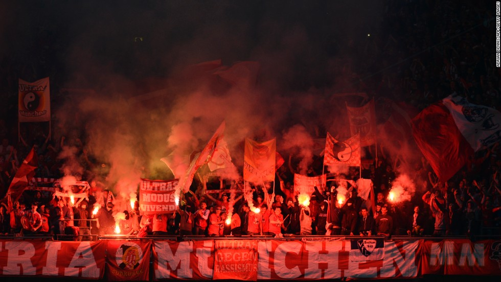Bayern Munich supporters light flares in the stands during the game.