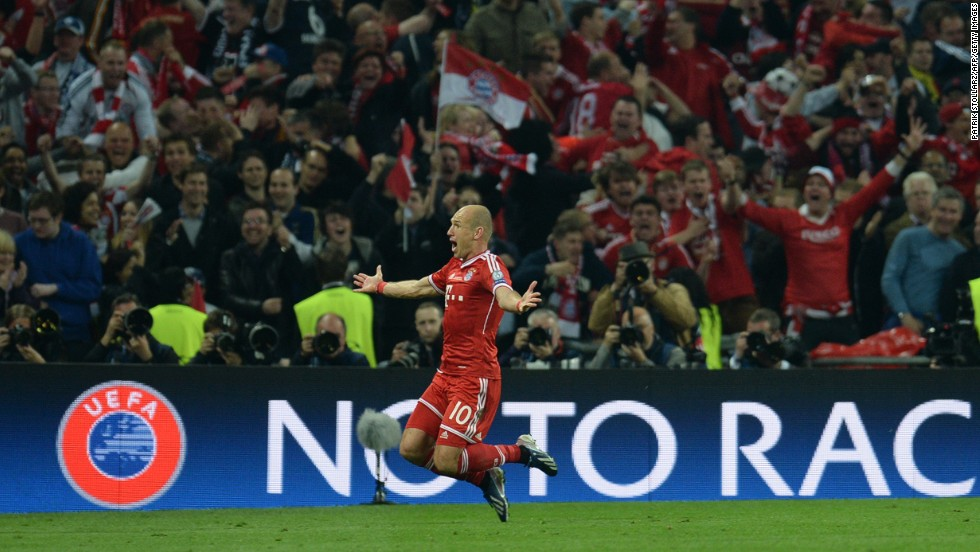Bayern Munich's midfielder Arjen Robben celebrates scoring the winning goal against Borussia Dortmund.
